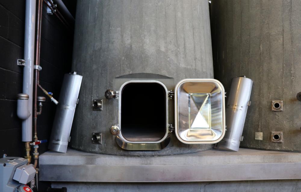 Concrete tank door open with filter